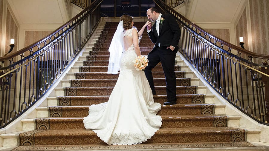 Bride and groom on staircase at Caesars Palace
